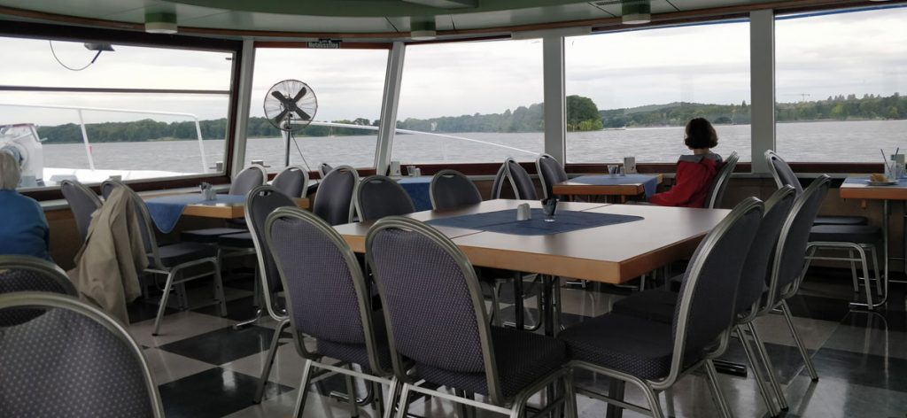 Indoor Room of the Boat with many tables